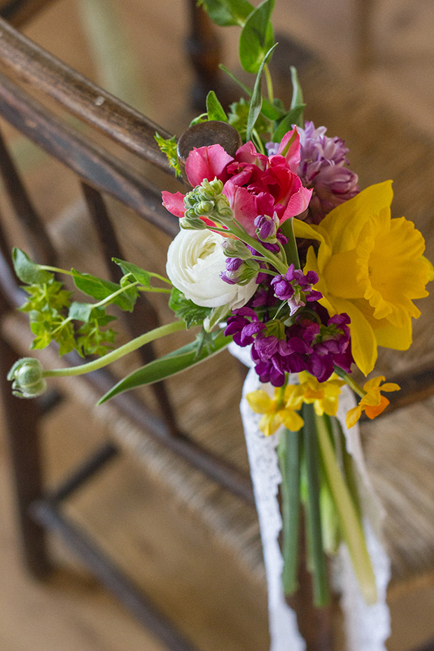 Village Hall Vintage Wedding-Bright Spring Flowers-Vintage Chair with Flower Posie