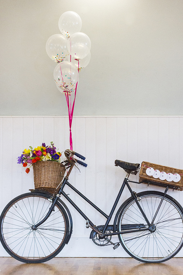 Vintage Amy Wedding Styling-Village Hall Spring Wedding-Vintage Bicycle with Confetti Balloons and Card Basket