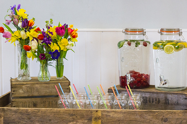 Vintage Amy Wedding Styling-Village Hall Spring Wedding Shoot-Rustic Bar with Spring Flowers and Jam Jars with Straws