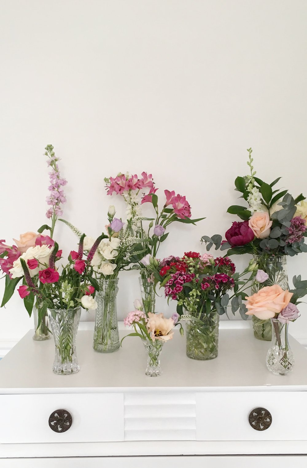 I have about 70 cut glass vintage vases! I love them and they are so versatile for weddings, scattered on a long table, popped on mantle pieces, a group on a round table or so much more. I often add to the collection at boot sales. All available to hire  here!