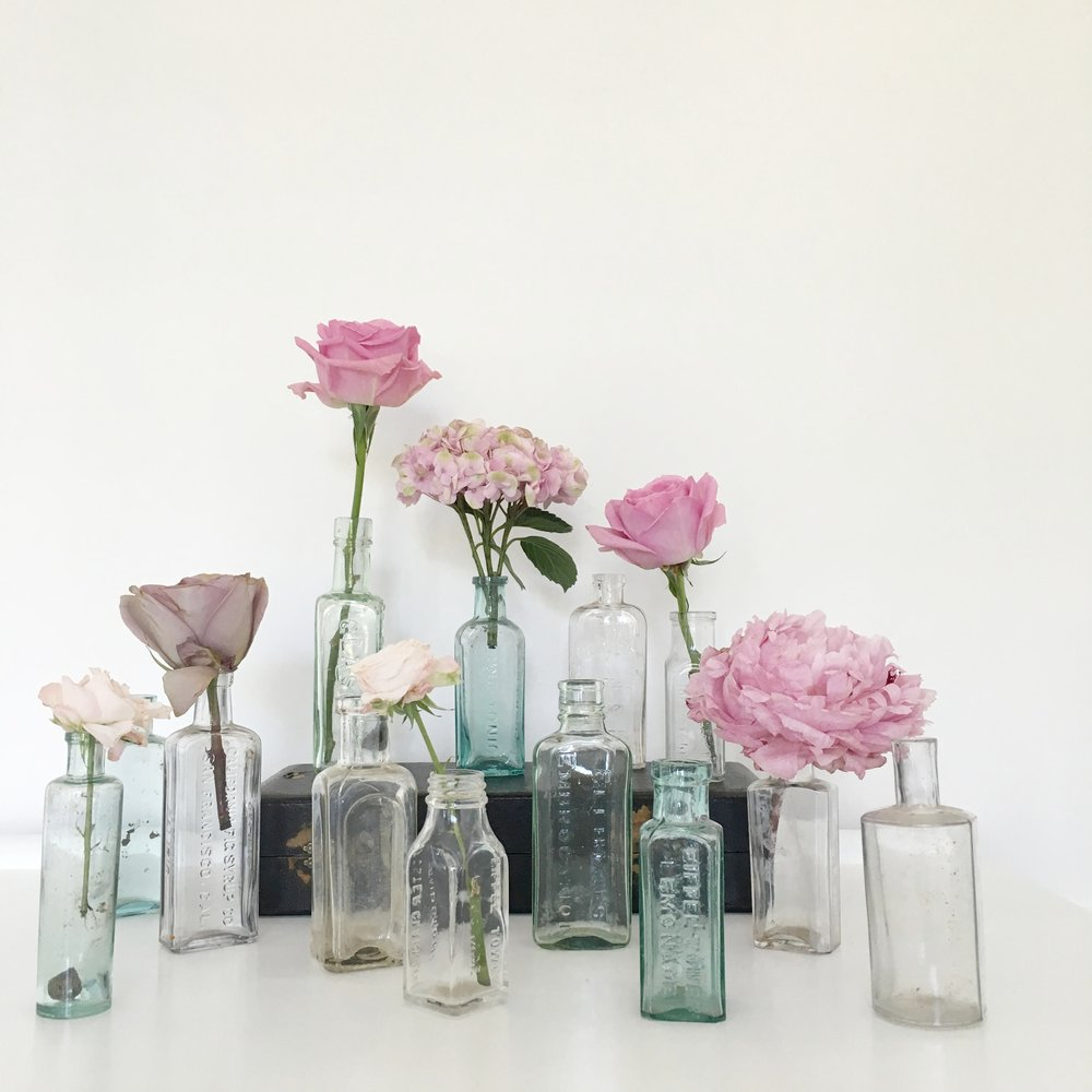 More of my beautiful vintage bottles, looking pretty with a single stem flower in for your vintage wedding, dotted around the venue or placed on the tables.