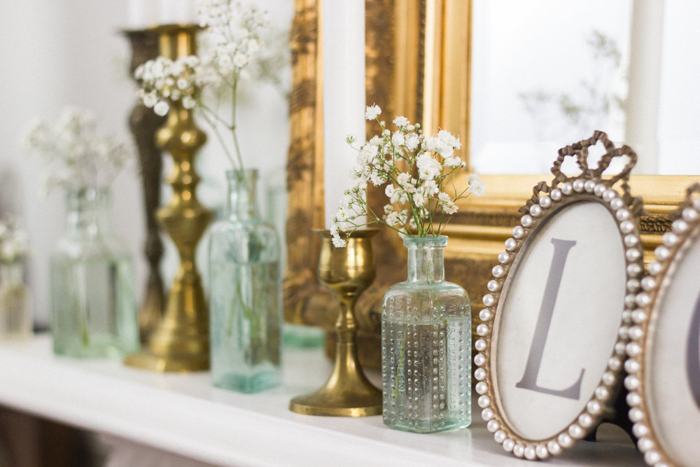 Vintage medicine bottles and vintage brass candlesticks are a perfect combination. Pop them around the room, dotted on tables or high-up on focal points.