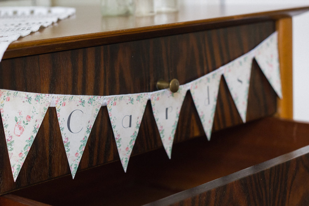 Pop some bunting in-keeping with your styling, or add a classy sign to show that guests can pop their cards in the drawer of a quirky set of drawers, dresser or sideboard.