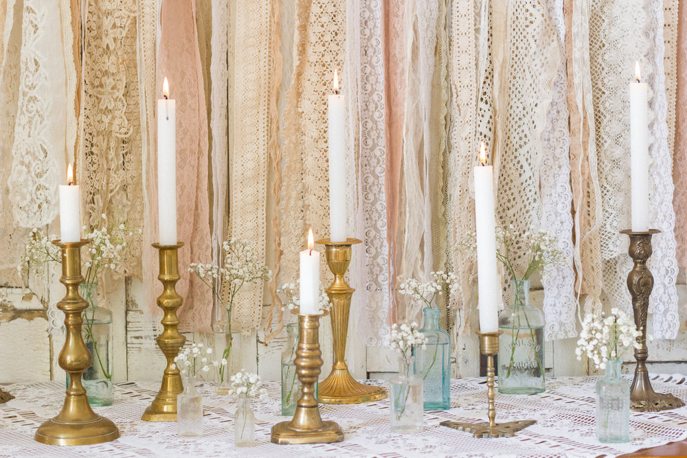 Vintage brass candlesticks are a versatile and reasonable way to add elegance and detail to your wedding.