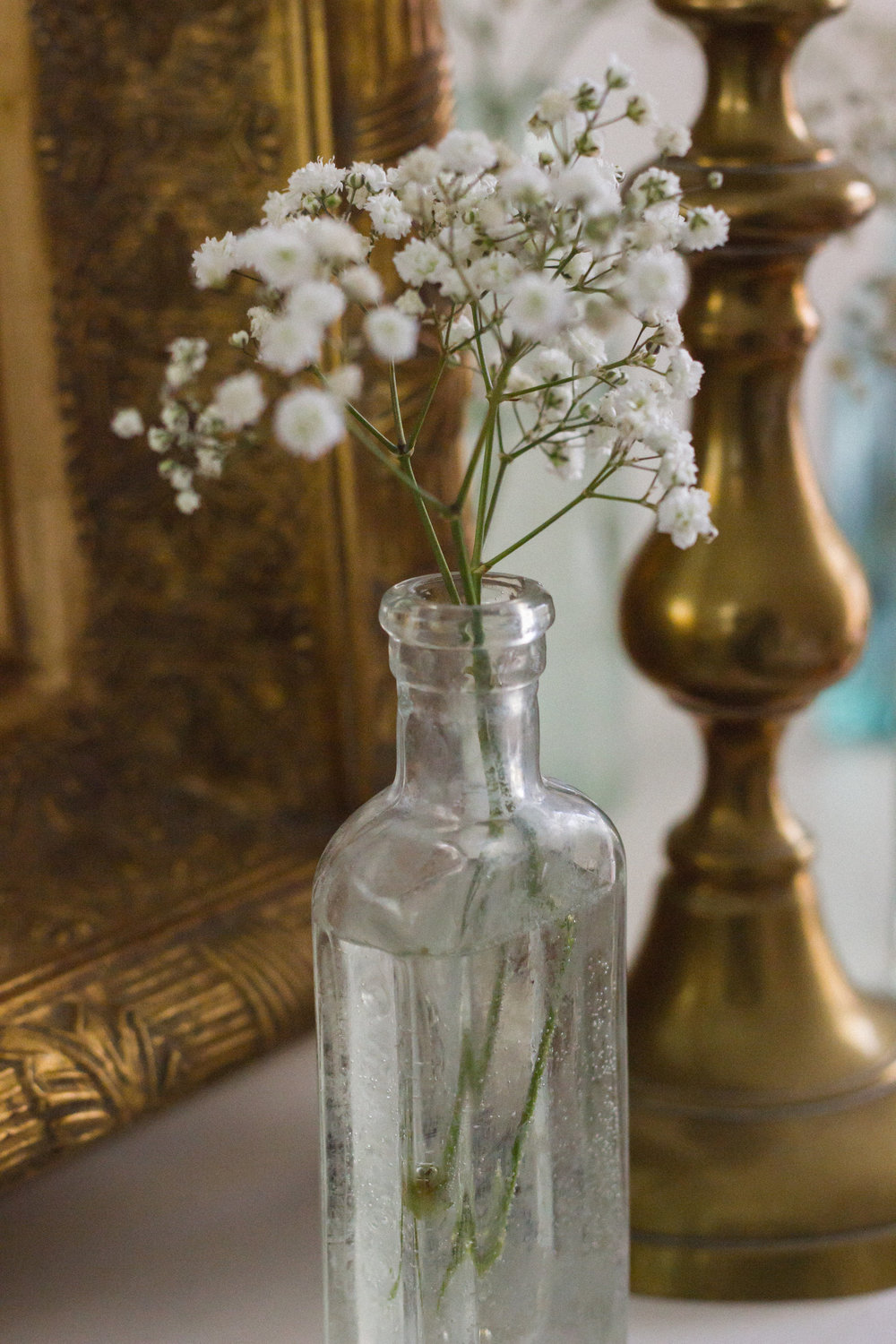 More of my pretty vintage medicine bottles that look so lovely with dainty blooms in them.