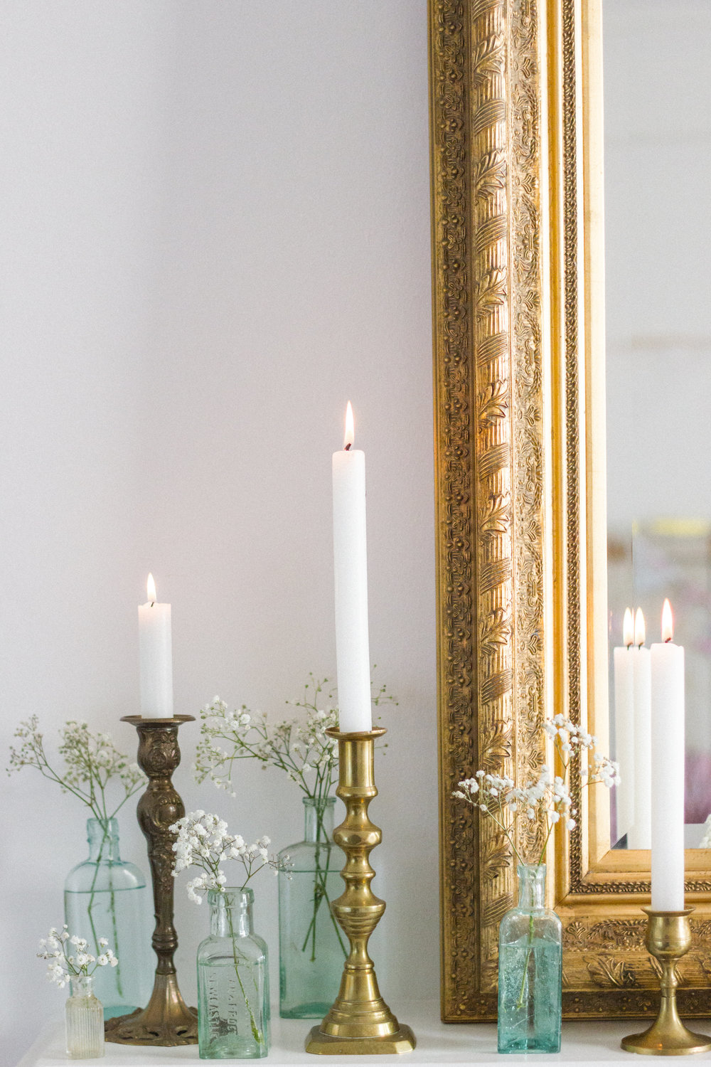 Create a stunning fireplace mantle with candles & bottles at alternate heights in-keeping with your style.