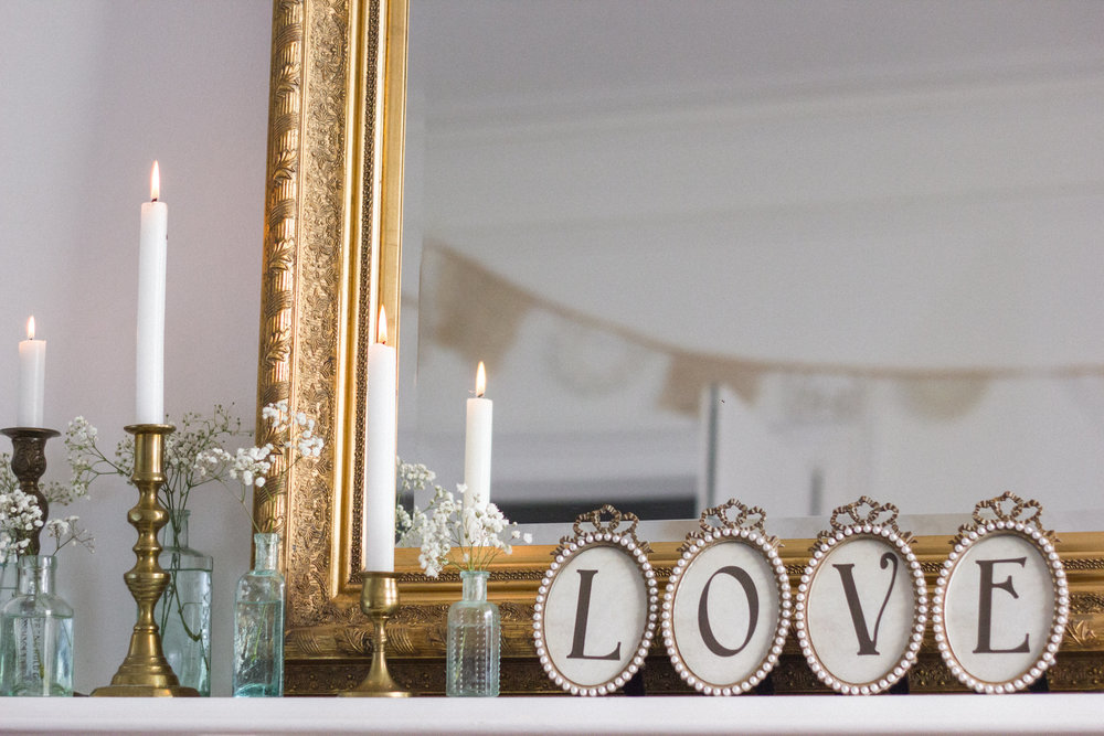 My love frames look so pretty styled on a mantle, shelf or dresser with other beautiful vintage items, like these vintage brass candlesticks and medicine bottles.