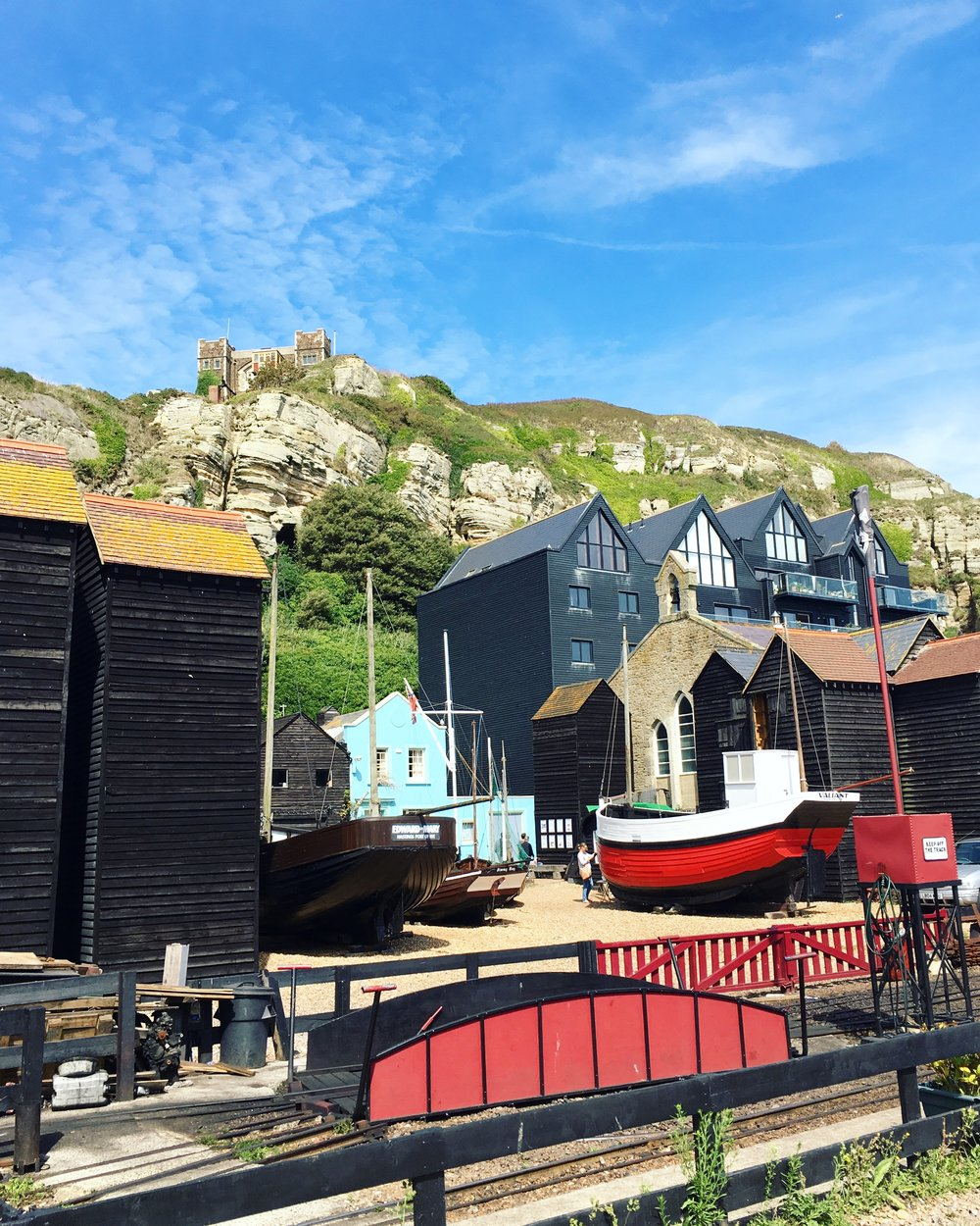 This of part of Hastings Old Town is one of my faves. I so love the traditional old Fisherman Huts that are still there, weathered from the sea and holding so much history. And that blue building peeking out makes my heart sing!
