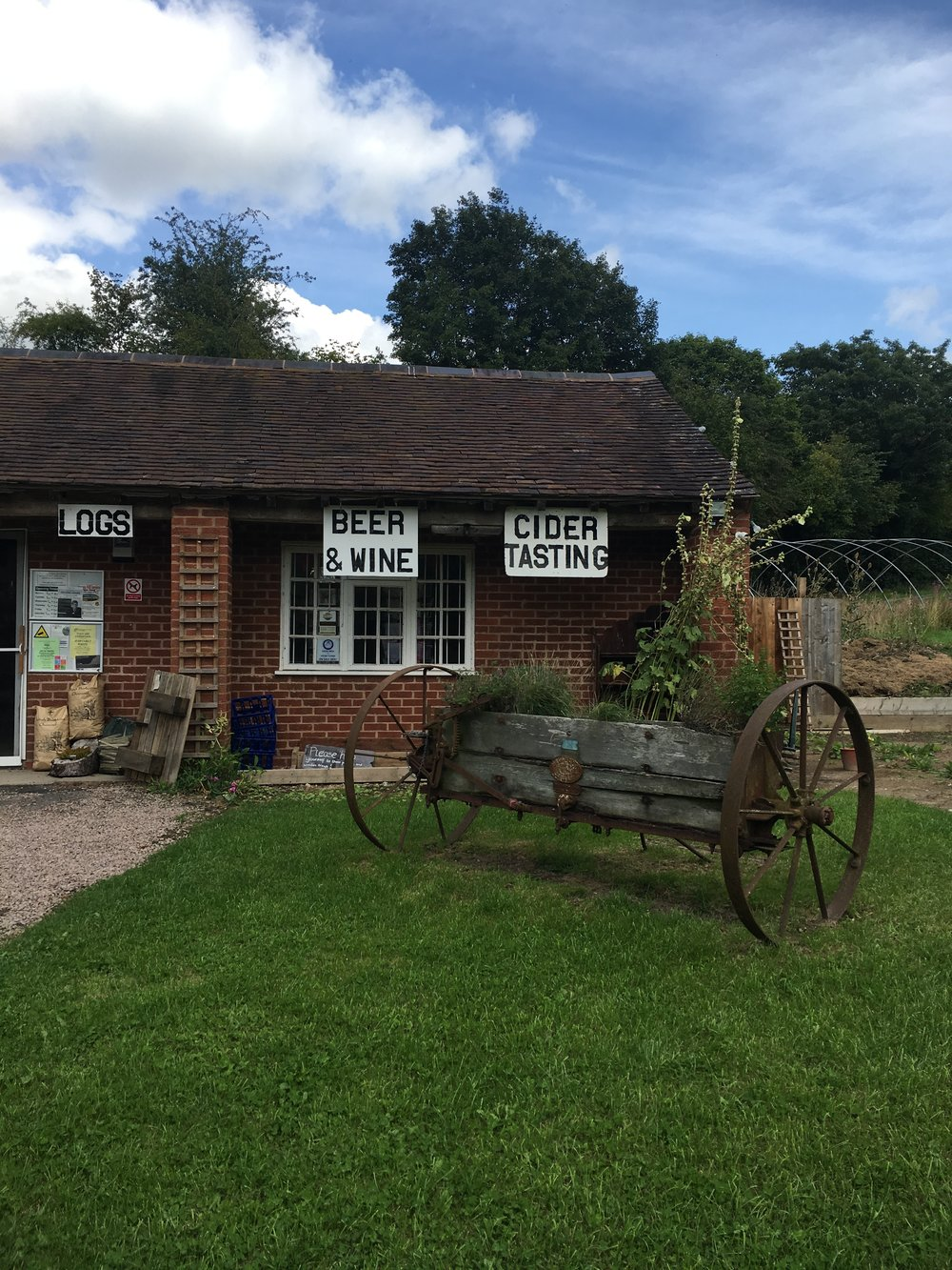 How cute is this quirky old farm shop? I love a farm shop but especially loved this one for its signage and old trailer display.