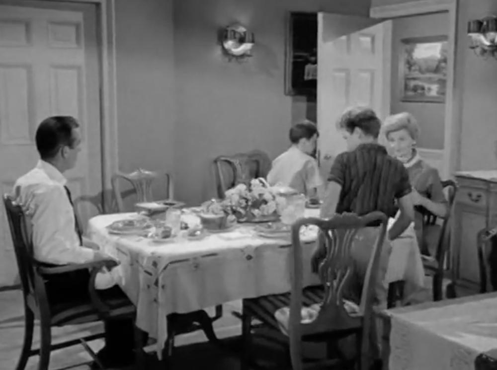 The Beav backs into the dining room