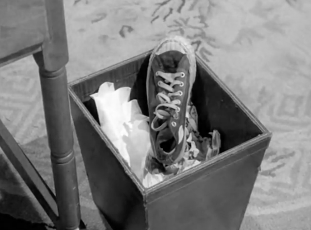 Of course the shoe is in the waste paper basket