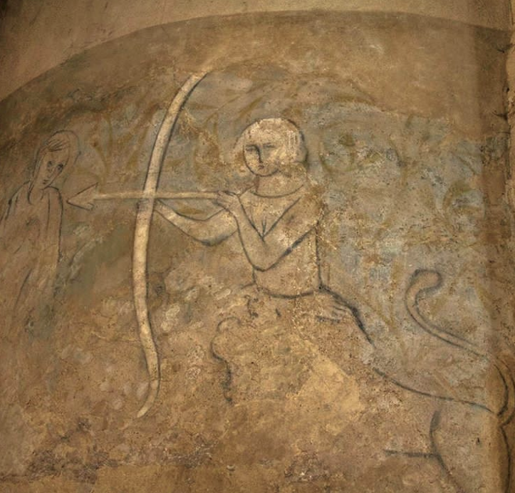 Image of a faded fresco in the castle which appears to show a chimera type of creature; a woman's torso coming out of a lion's head.  Notice that the bow is drawn with the lion/woman's left hand, an archaic symbol of evil, and aiming at what looks like another woman.