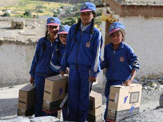 Locals in Nepal benefit from computers provided as part of the work done by  Future Generations University . Photo: Future Generations University Website.