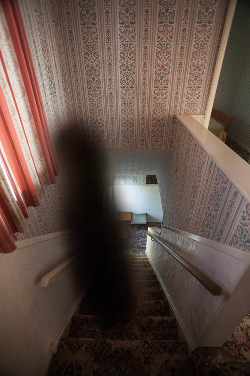 "Image of a ""blacker than black"" shadow on the stairs of the house, from the  30 East Drive website .  Photo taken by visitor Craig L."