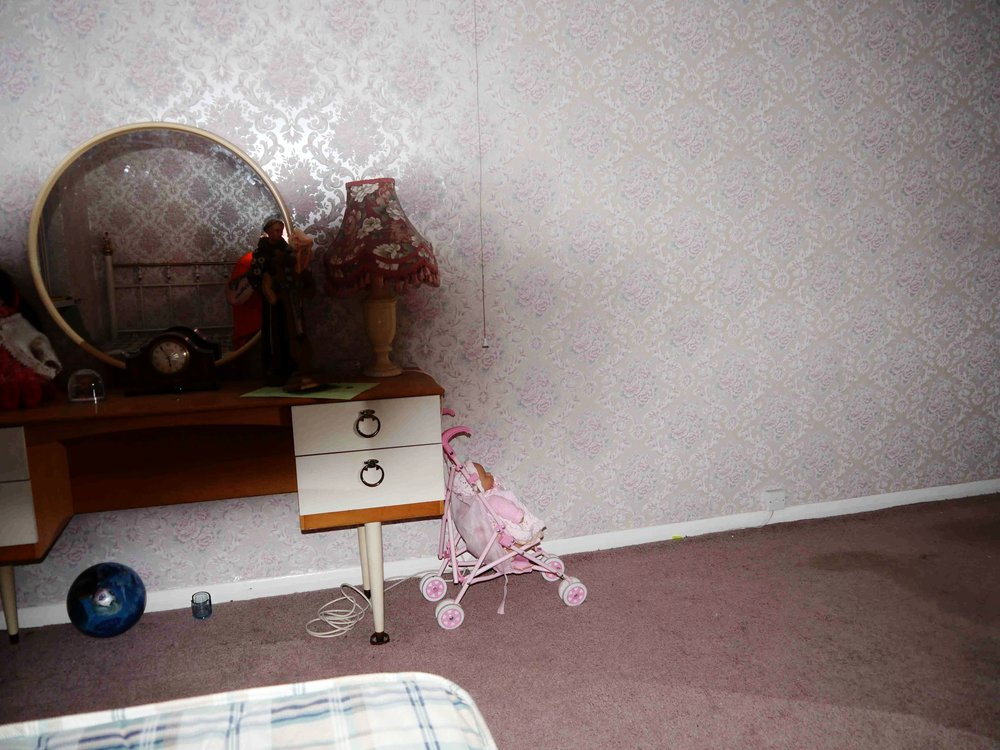 The shadow in Diane's room.  The baby stroller, snow globe and ball if taken elsewhere, end up back in this room.  From the  30 East Drive website , photo by Steven J.