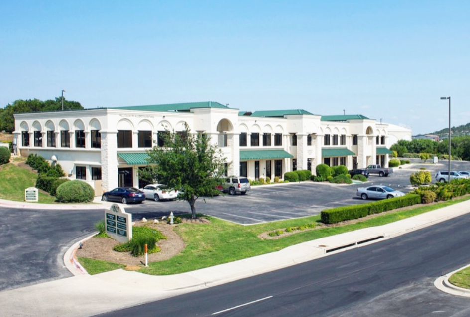 Our studio is located in the building facing the road, right next to Keller Williams. The building was originally the Lakeway Aquatic Center for reference.