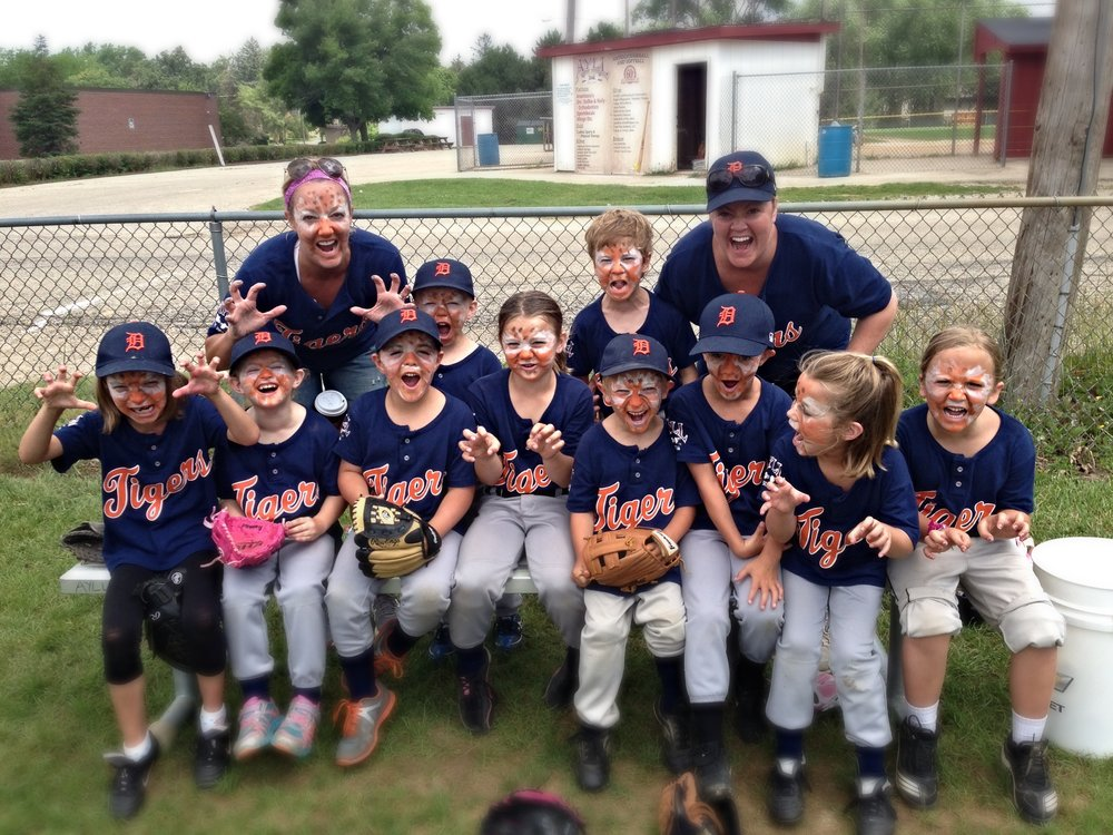 My sister and I with our ferocious t-ball Tigers.