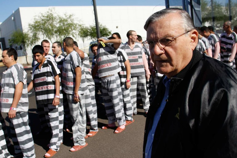 Joe Arpaio holding his favorite kind of pajama party.