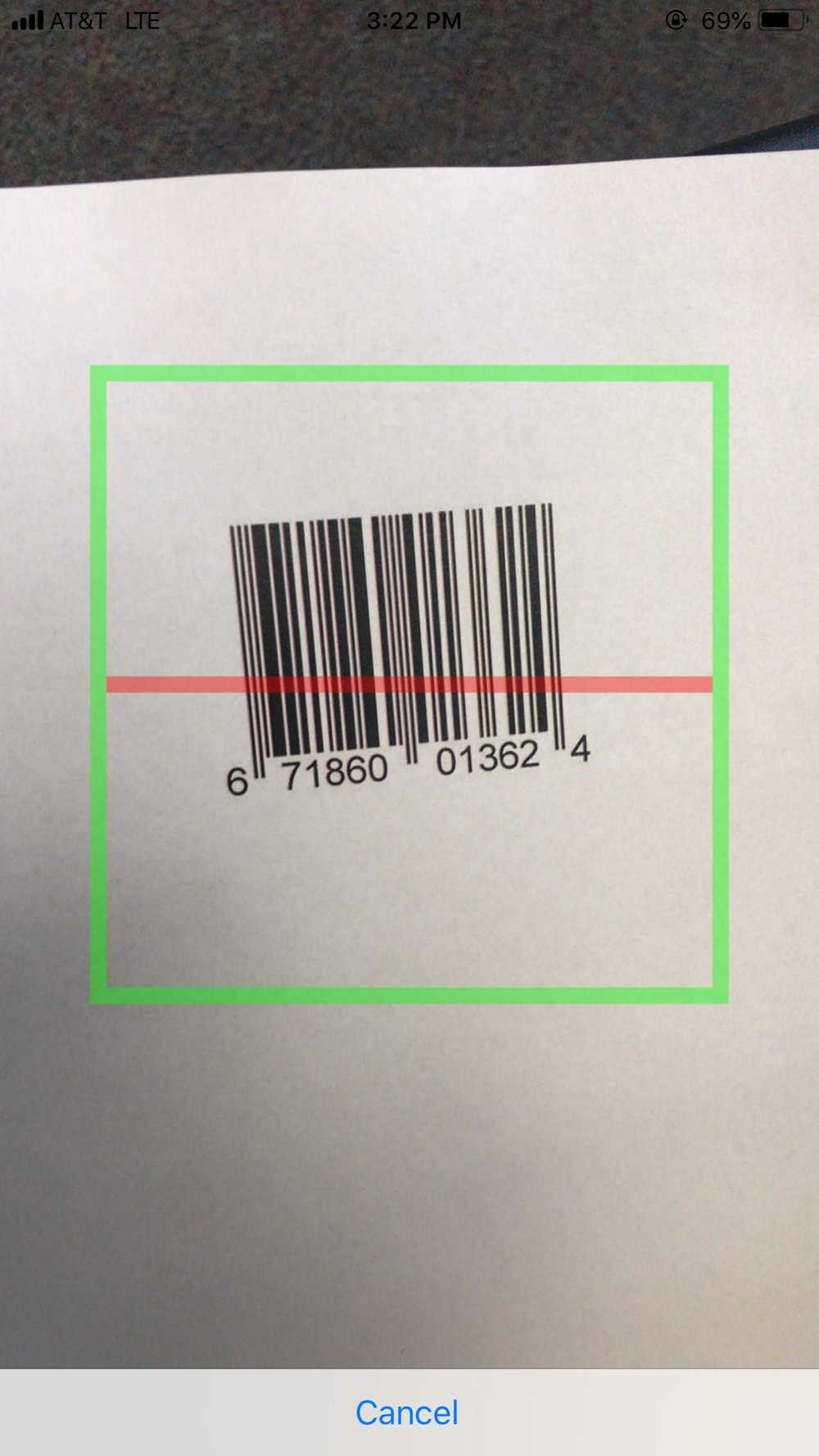 When 'Scan' is tapped, the camera captures the barcode data