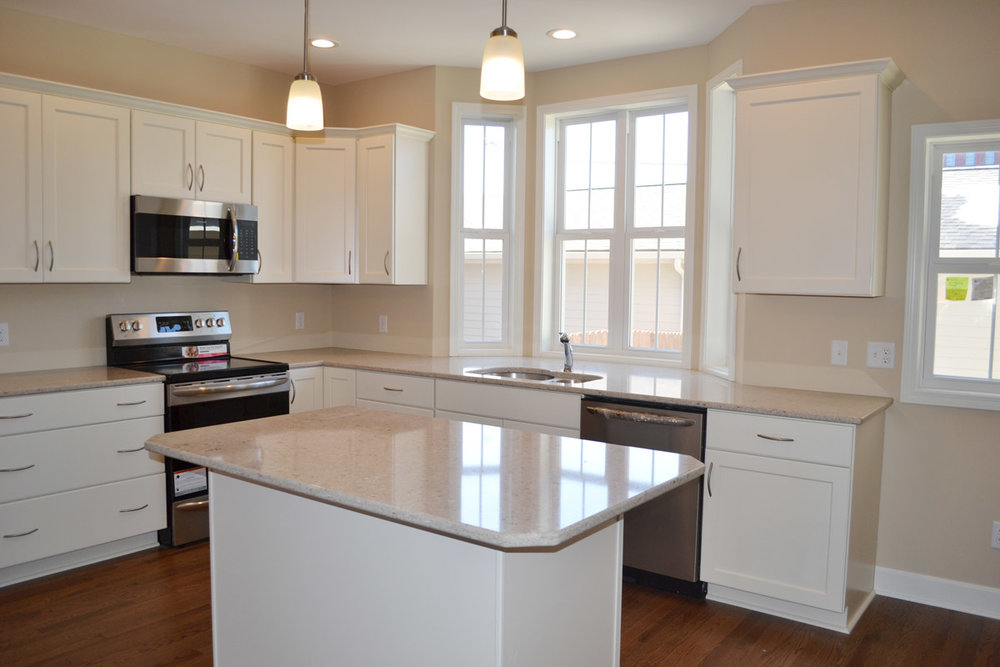 #111 White Kitchen Cabinetry with Granite Countertops