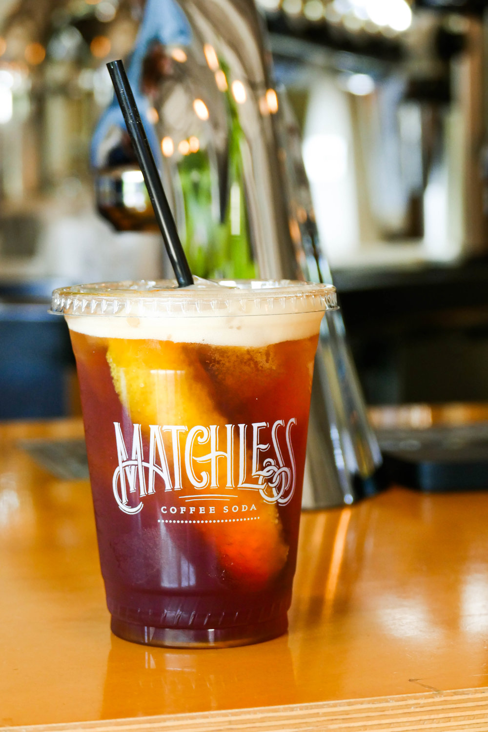In 2012 Nathanael Mehrens had an idea that would change the face of Nashville specialty coffee forever: coffee soda. A cold, carbonated coffee drink that's subtly flavored with orange: slightly sweet and so refreshing. It quickly became a local hit and Mehrens, along with his partners Jamie Cunningham and Sean Stewart approached Ben Bredesen (Owner of Fat Bottom Brewery) about helping them to turn their coffee soda into a viable brand.  He, along with his partners, invented a way to brew large batches of coffee that maintained the character and terroir of its origin. This means that the taste can vary slightly season by season. During this time, the trio simultaneously opened their own café in germantown called Steadfast Coffee and put their coffee soda creation on tap there. It soon became an award winning local Nashville favorite and one of their top sellers. We are proud to partner with  Matchless  and hope you will enjoy a refreshing cup of coffee soda while shopping.