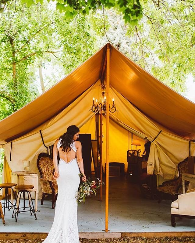 @lyonsfarmette glamping tent with the glamorous bride Ashley @queen_ofthemountain !!😍 . . . . . Venue: River Bend @lyonsfarmette Planning: @dahliaeventslyons Photographer: @redaspenphotography Florist: @flower_tribe_co Caterer: Smoke Shack  Bartender: Smoke Shack  Band: @professionalfolk Rentals: @linenhero @allwellrentsdenver Hair: @shearabby Transportation: @bustoshoworg Dress: @grace_loves_lace