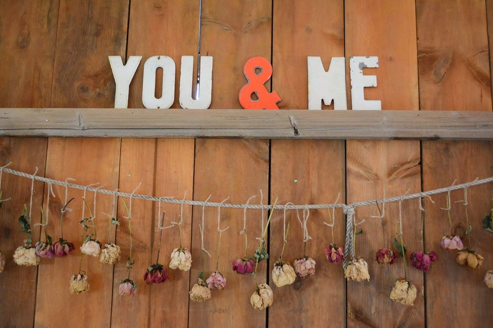 "My cousin's wedding had dried flower garlands and retro letters paired for a hip take on ""country style"""