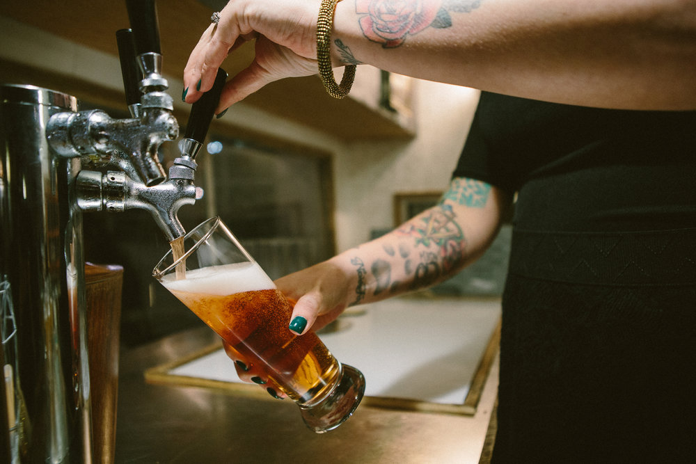 Not all poured beer will look as good as this. This level of cool is dependent on my bartender Ali's very awesome arms and nails. Photo by Angie & Paul Photography