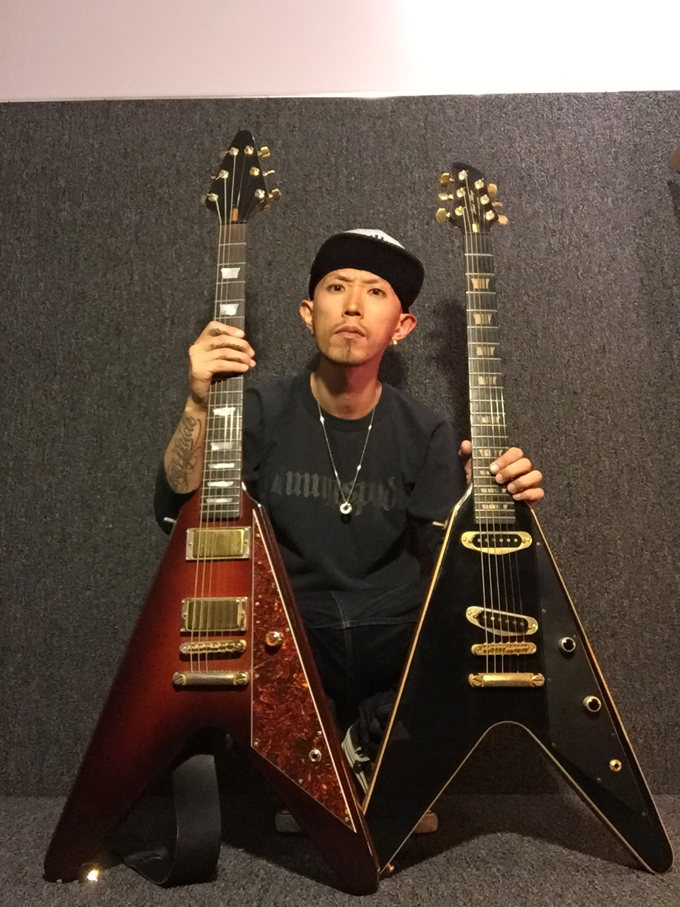 Daisuke Wache of Divine Era with custom guitars