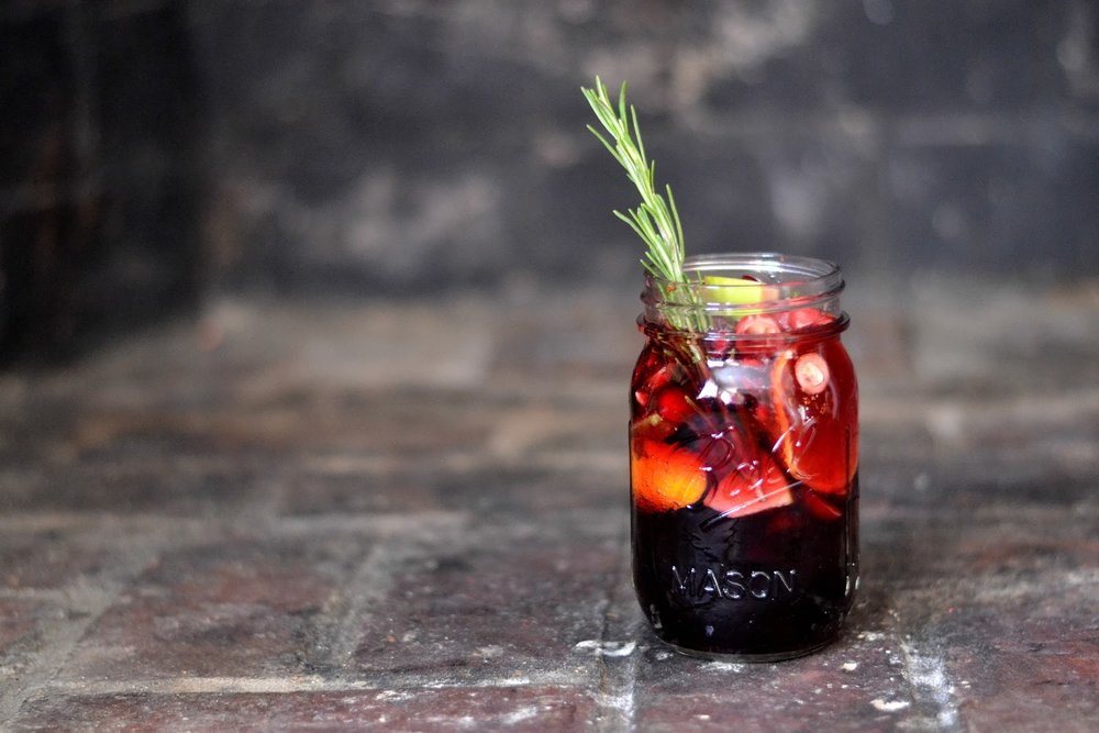 Sangria isn't just for summer.  Make this holiday twist mixed with apples, pomegranate, cranberries, clementines, and a hint of rosemary. It's the  perfect eff you to the chilly winter.        Make this drank from Bakeaholic Mama