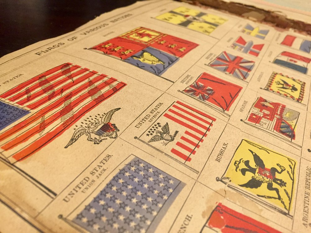 A page from my great grandmother's Peerless Atlas of the World depicting flags of the nations (from 1894)