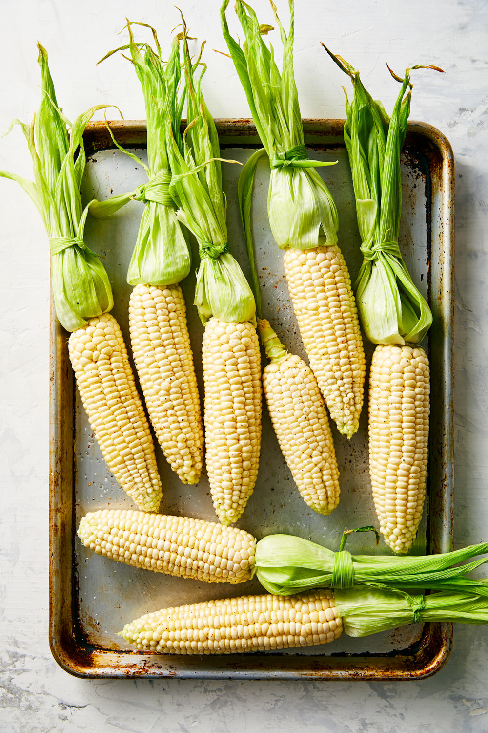 fresh-corn-on-the-cob-peeled-on-baking-pan.jpg