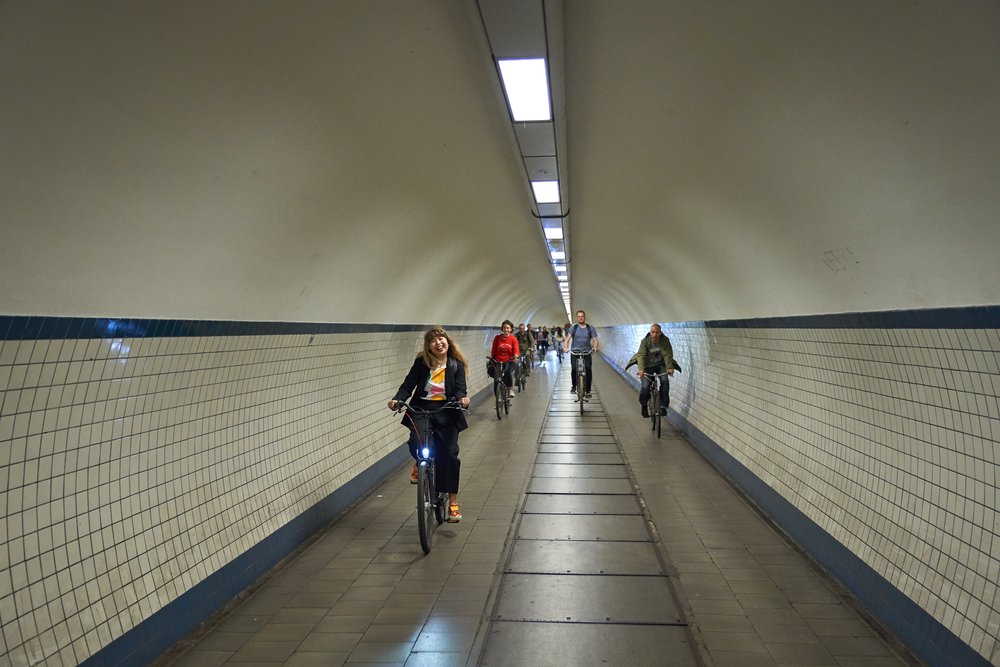 Biking through St. Anna's Tunnel. Photo by  Niko Caignie .