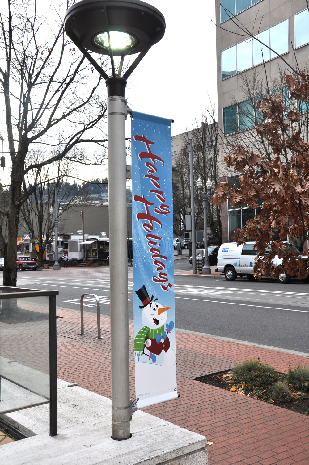 Unitus Holiday Greetings snowman vertica sign