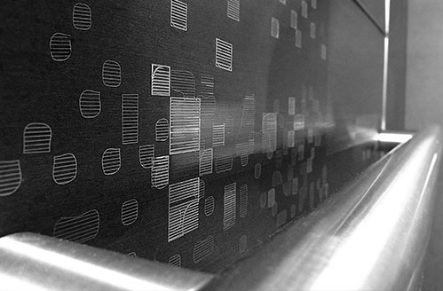 Elevator Graphic Panel The artwork expresses a 'fragmented urban history in motion' focusing on iconic structures and events in Montréal.