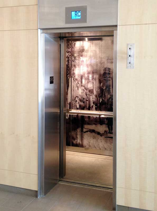 Elevator Graphic Panel   The artwork expresses a 'fragmented urban history in motion' focusing on iconic structures and events in Québec.