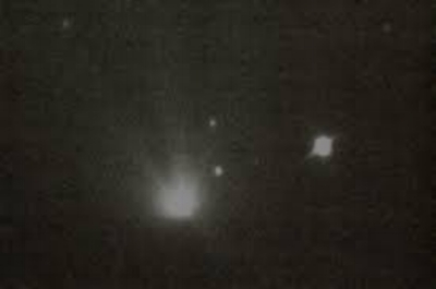 Photo of apparent UFO following the Hale-Bopp comet, taken by Chuck Shramek