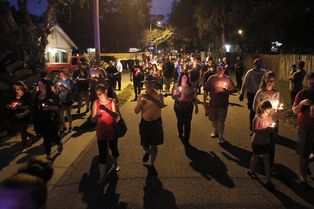 The Seminole Heights community holds a vigil for the victims