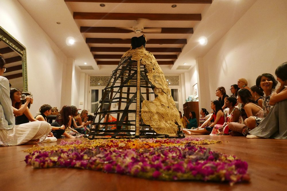 """Guests were sitting on the floor around the """"Daughter of the Soil"""" installation creative an atmosphere of wonder and intimacy."""