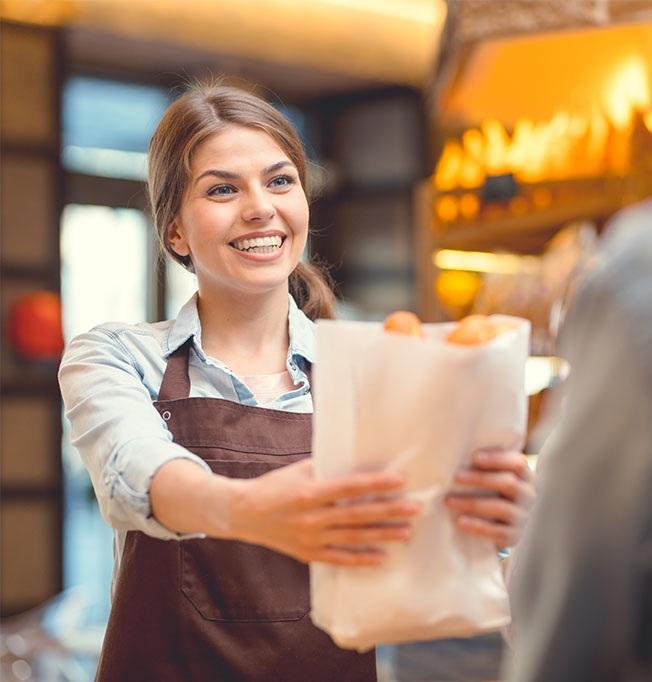Young+baker+and+customer+at+the+counter-1.jpg