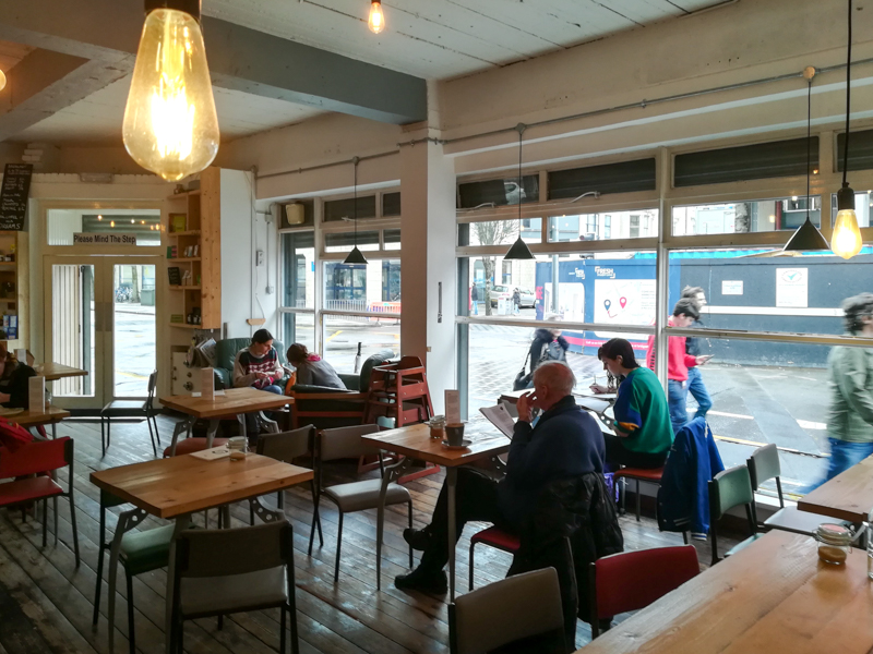 Tables with people working in Little Man Coffee, Cardiff