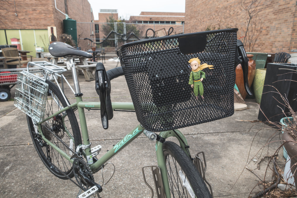 I'll be writing at some point about why I think a front basket makes more sense for this trip than the handlebar bag I've used in the past. This basket is the KLICKfix Mini (petit prince not included).