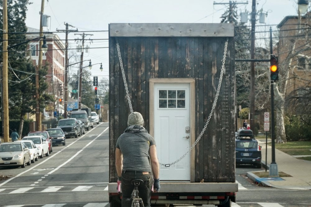 Escorting a tiny house by bicycle through the District of Columbia.