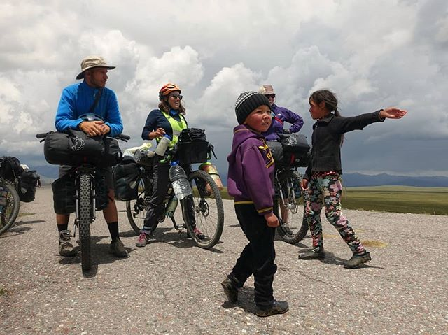 On our way to the Kyrgyz border, these cute kids stopped us to see if we wanted some hot tea, fresh bread, or a rest in their nearby yurt. With a storm brewing on the horizon, we were all too happy to duck for cover and spend a little time with this lovely family. ⛈️⛺🌩️ (Quick little blizzard hit just a few hours later.)
