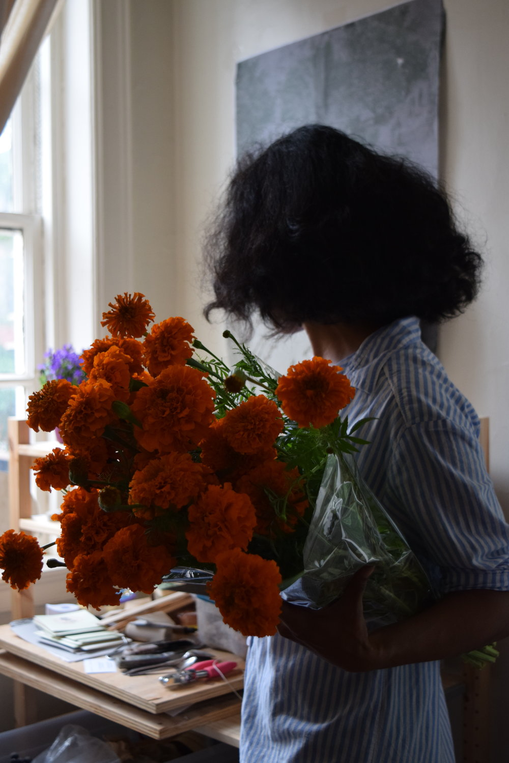 - Just before doing the Dorene Collection photoshoot, I picked up some marigolds from the farmer's market in Rittenhouse Square. I didn't necessary think that they were going to be used for anything but my own need to always have fresh cut flowers in my place.  I'm glad I did. These little beauties ended up being the perfect non-prop prop. They popped up in most of the picture Amy took. So let's follow the marigold-round.