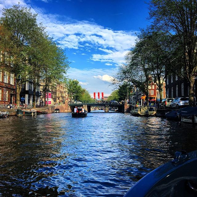 Amsterdam from the canals. A pretty shot from an evening spent on a boat in the beautiful city of #Amsterdam.  From the flower market to the central station, through De Jordaan, De Wallen, De Plantage and the old port of the city, I really loved to see the city from the water. . . . #amsterdam #canal #boat #privatetour #water #sunny #august #summer #netherlands #nederlands #grachten #deWallen #redlightdistrict #city