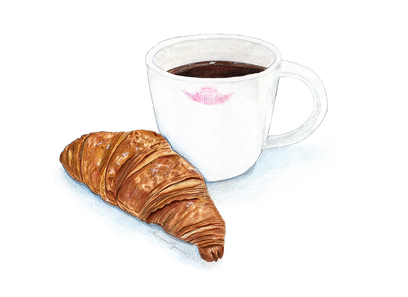 Typical breakfast duo of coffee and croissant.