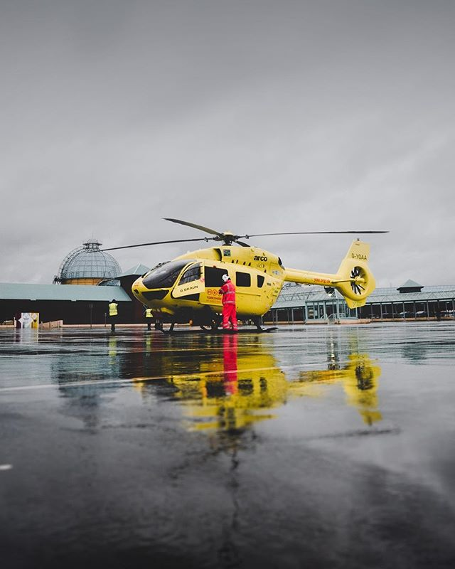 Still from a shoot with @yorkshireairambulance the other week at @lovemeadowhall.  The rain made for some moody footage and really nice reflections!  These guys are out in all weather doing amazing work, supported entirely by people's generous donations.  yorkshireairambulance.org.uk/donate/  Photo: @sam_wlkr . . . #yorkshire #yaa #yorkshireairambulance #helicopter #airambulance #meadowhall #sheffield #alphacollective #puzzleglass #a7rii #yellow #contrast #igmillionssquad #sonya7rii #cityscape #shoppingcentre