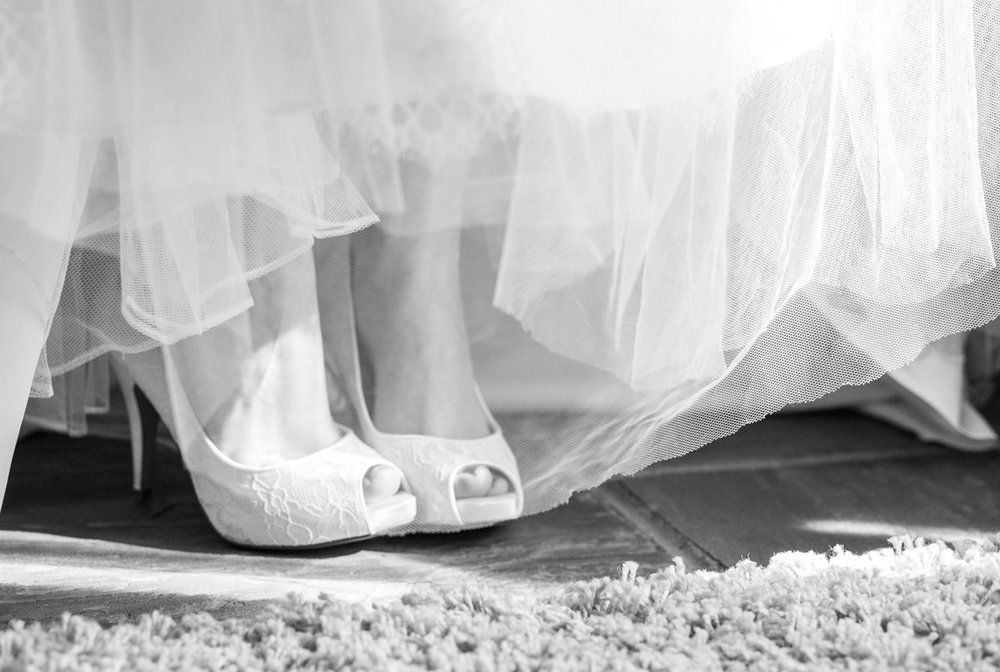 Rivervale barn wedding photography, sussex wedding photographer, bridal shoes
