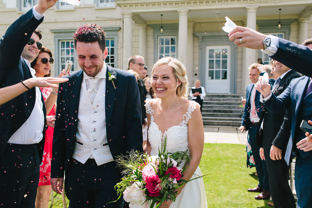 confetti at buxted park hotel, sussex wedding photographer
